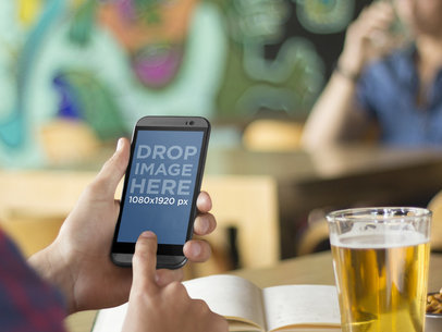 Mockup of College Student Using Android Phone and Studying While Out Having a Beer