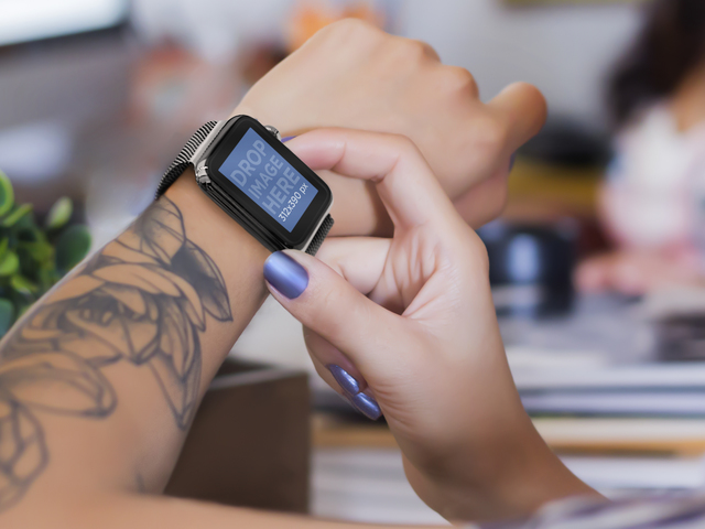 Young Tattooed Woman Using her Black Apple Watch Mockup Template