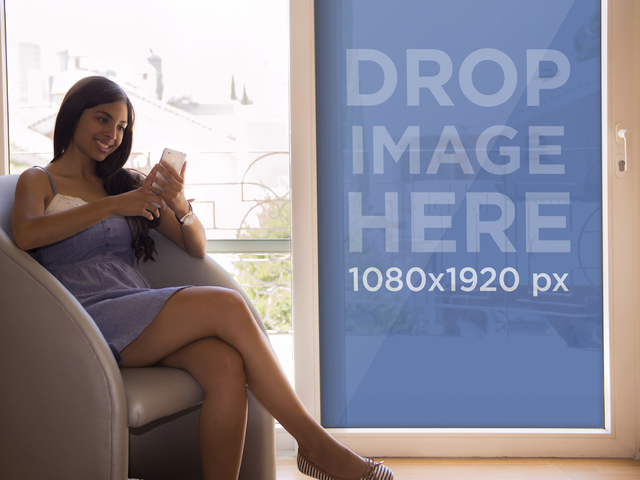 iPhone Mockup of Young Woman Sitting by the Window Placeit Stage Image