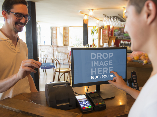 Man Making a Sales Transaction at a Restaurant Using LG Monitor Placeit Stage Image
