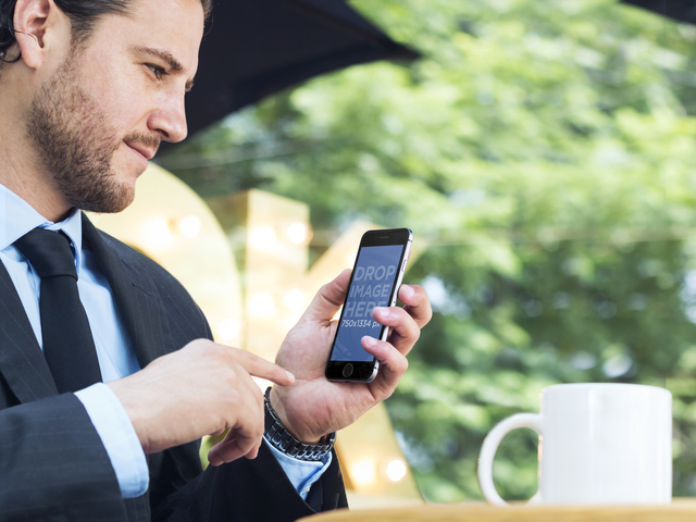 iPhone Stock Photo Featuring a Businessman Using an iPhone 6 at Outdoor Coffee Shop