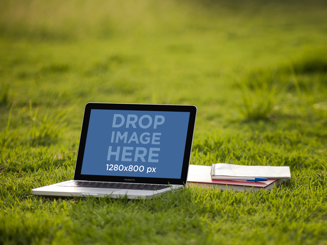 Stock Photo of a Macbook Pro Next to Notebooks at the Garden Placeit Stage Image