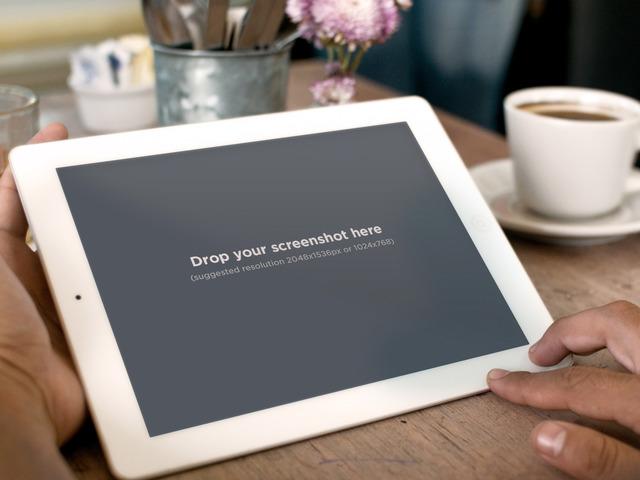 Holding White iPad 2 Coffee
