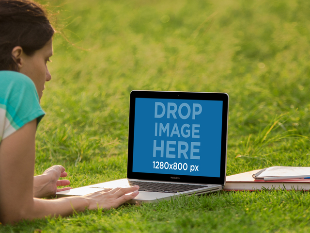 Laptop Mockup of a Girl Working on her Macbook at the Park Placeit Stage Image