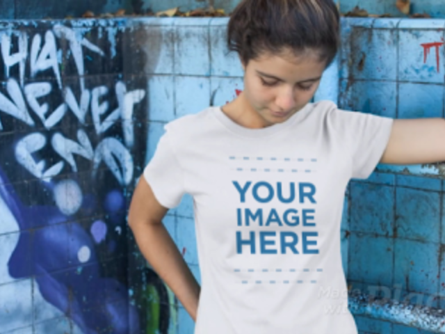 Smiling Young Woman at a Skate Park Wearing a Tshirt Video Mockup 12859