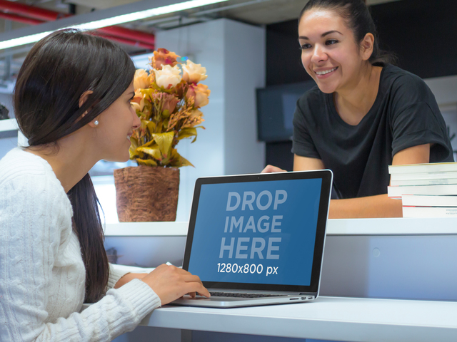 Macbook Mockup of Two Ladies at the Library a4544