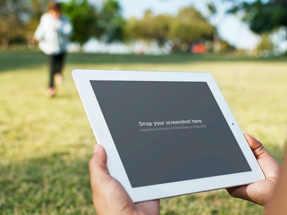 Running at the Park With White iPad