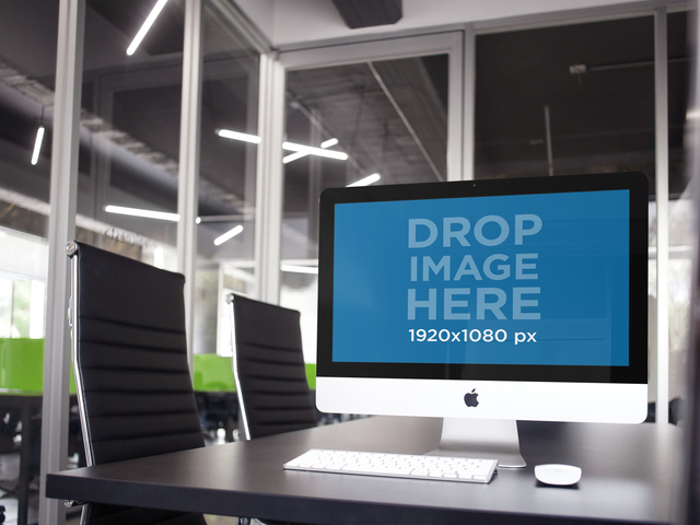 Placeit Mockup Of An IMac At An Office Conference Room