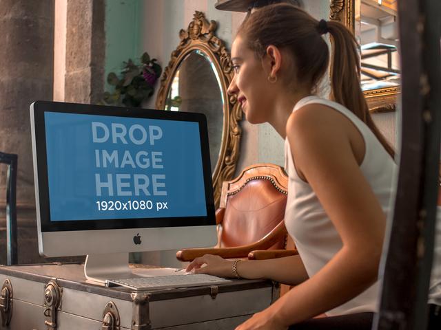 Saleswoman at a Vintage Store Using an iMac Mockup a4852-std