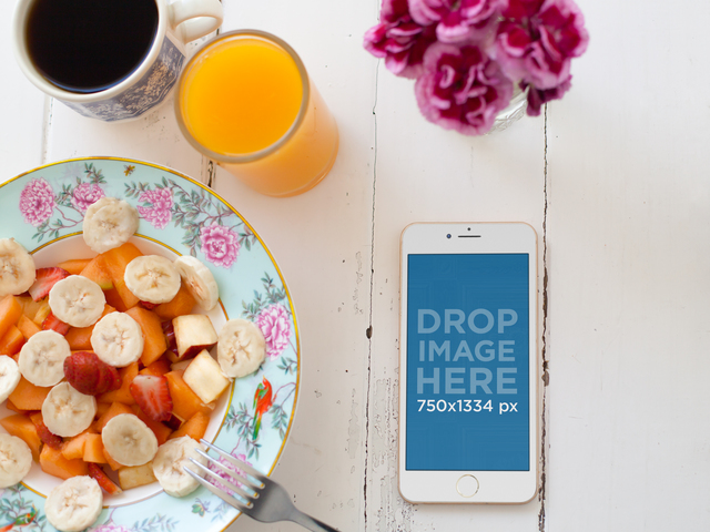 iPhone 6 Sitting Next to a Fruit Plate Mockup a5544
