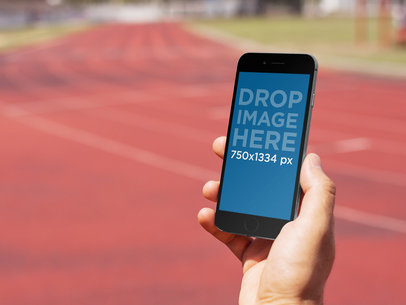 iPhone 6 Mockup Generator at a Running Track a5549