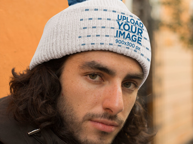 Placeit - Mockup of a Handsome Man Wearing a Pom Pom Beanie 2d3bdd35cd2