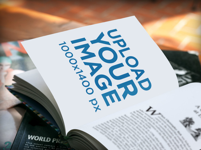 Mockup Featuring a Book Lying Open Over a Stack of Magazines a5909