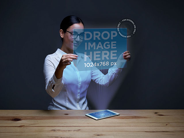 iPad Mockup of a Young Woman Interacting With a Projection a6174
