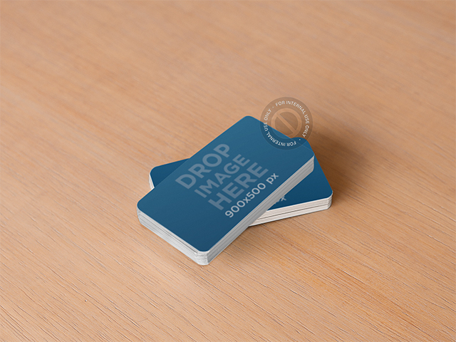 Mockup of a Stack of Business Cards Sitting on Top of a Wooden Desk 6276
