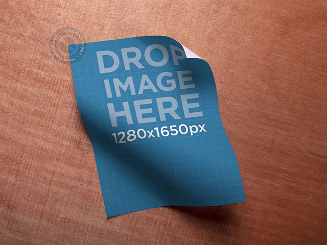 Poster Mockup Lying on a Wooden Surface a6212