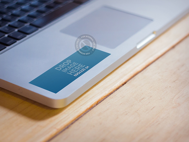 Mockup Featuring a Sticker Pasted to a Macbook Pro a670