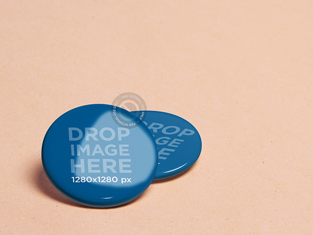 Branding Mockup Featuring Two Pins Over a Colored Background a6369