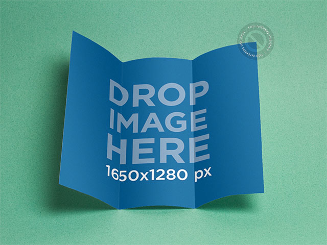 Open Tri-Fold Brochure Mockup Over a Solid Backdrop a6350