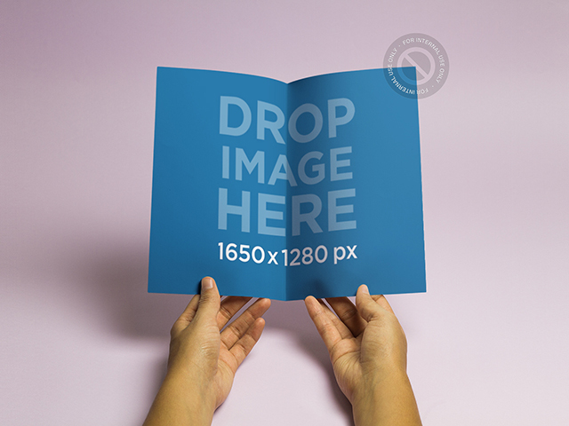Brochure Mockup Featuring a Woman Holding a Brochure a6363