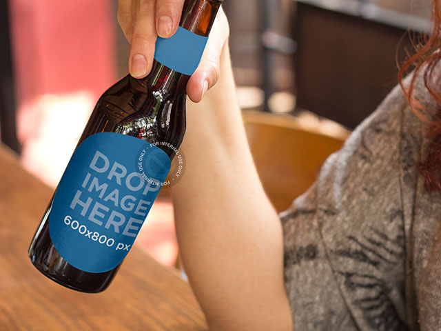 Label Mockup of a Woman Having a Beer at a Bar a6856