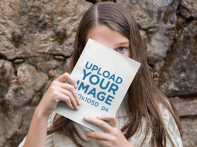 Parallax Video Mockup of a Girl Hiding Behind a Book 25922