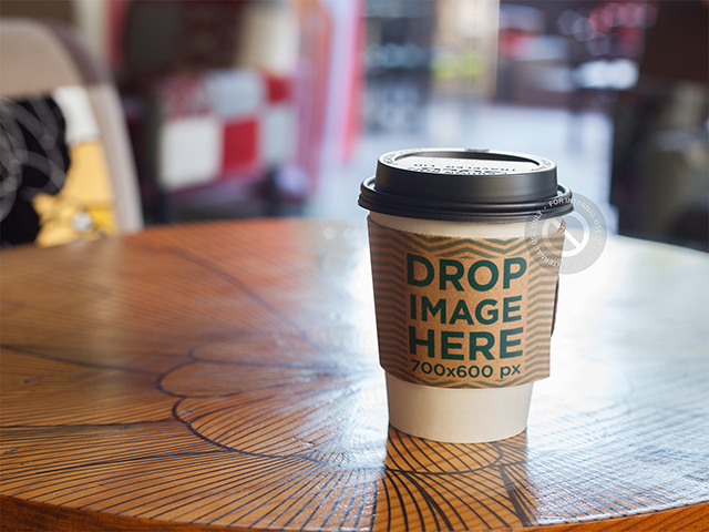 Takeaway Coffee Cup Mockup on Top of a Café Table a6684