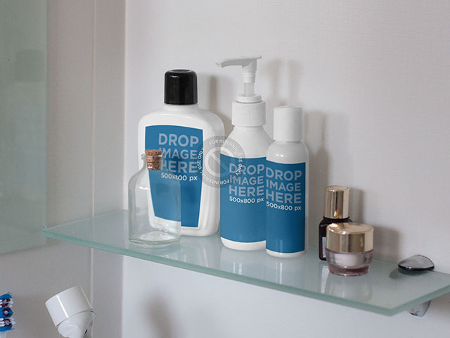 Label Mockup Featuring a Set of Bottles on a Bathroom Shelf a7265