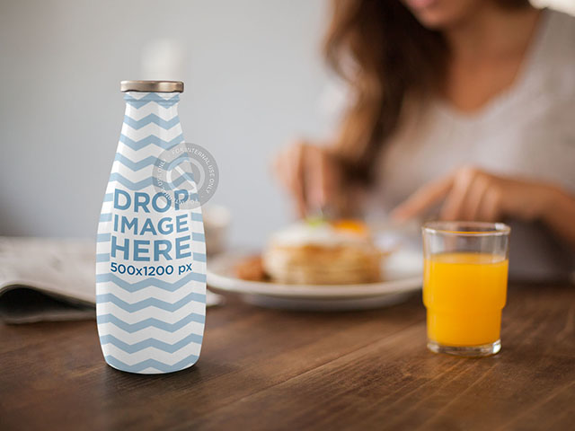 Label Mockup Featuring a Milk Bottle on Top of a Breakfast Table a7013