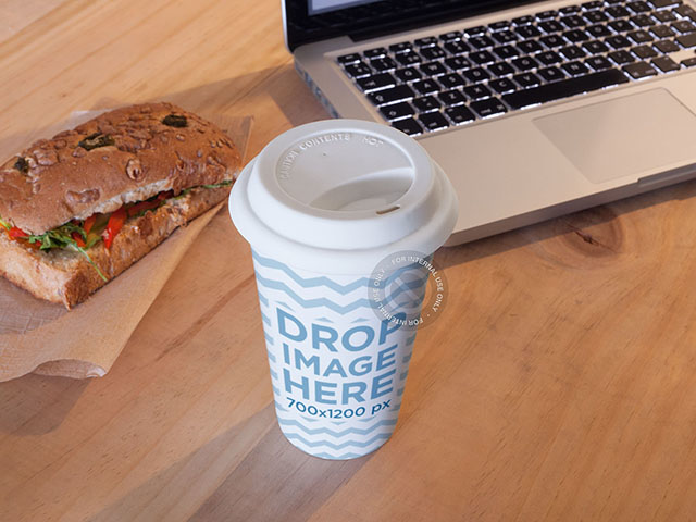 Coffee Cup Mockup Sitting Next to a Sandwich and a Macbook Pro a6786