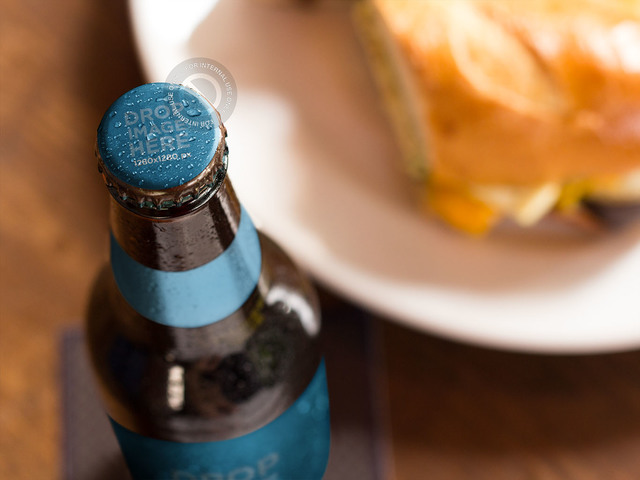 Label Mockup of a Beer Standing at a Restaurant Table a6851