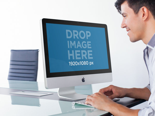 iMac Mockup of a Man Working in an Office Meeting Room