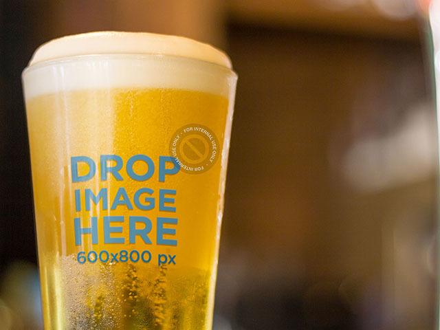 Label Mockup Featuring a Beer Glass at a Table a6956
