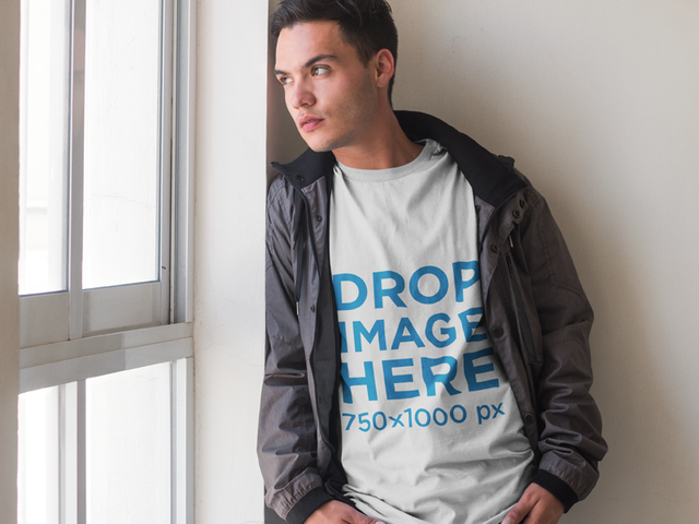 T-Shirt Mockup of a Young Man Looking Out the Window 7288a