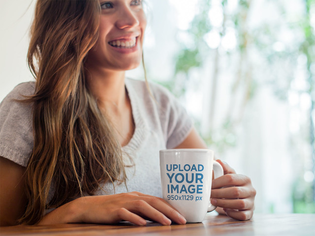 Cup Mockup of a Smiling Young Woman Having a Cup of Coffee