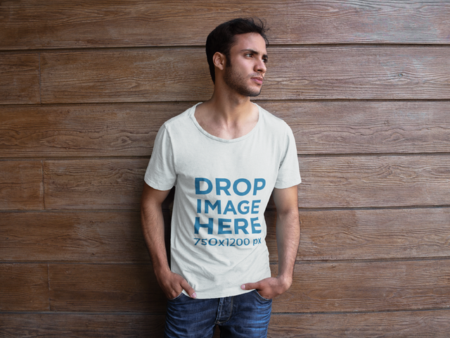 T-Shirt Mockup of a Man Leaning Against a Wood Wall 6496a