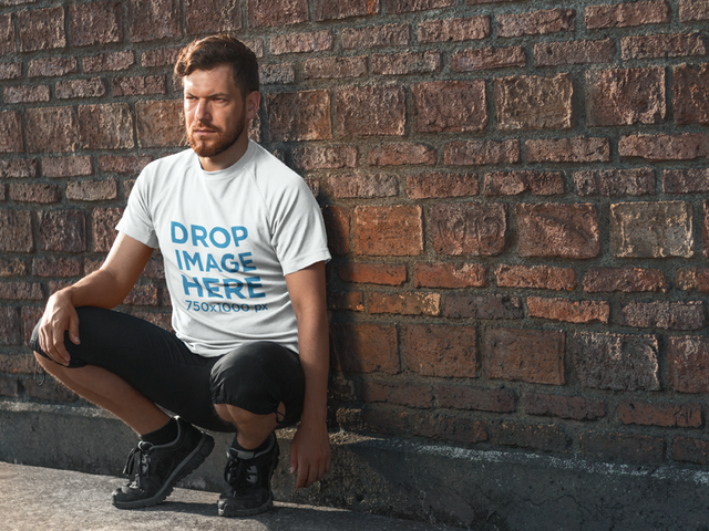 T-Shirt Mockup Featuring a Bearded Man in Sportswear 7217a