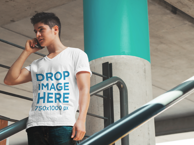 T-Shirt Mockup of a Young Man Talking on the Phone 5578a