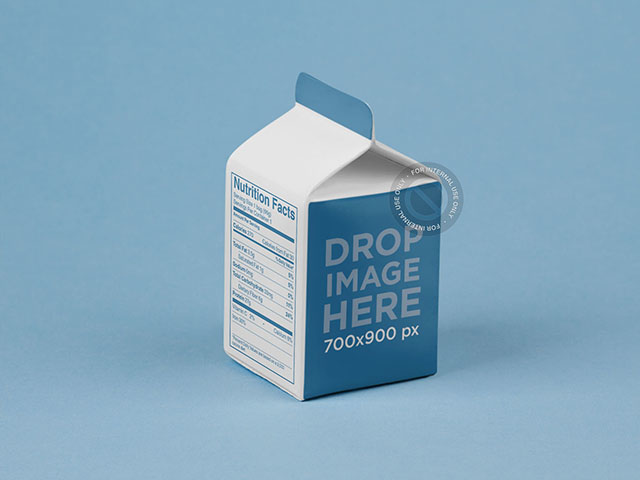 Packaging Mockup Featuring a Juice Box Over a Flat Surface a6889