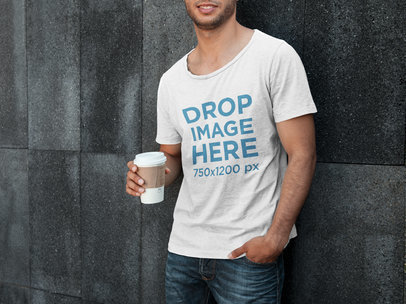 T-Shirt Mockup Template of a Young Man Holding a Cup of Coffee 6500a