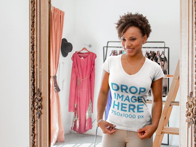 T-Shirt Mockup of a Girl Trying on Clothes at a Boutique 6576a