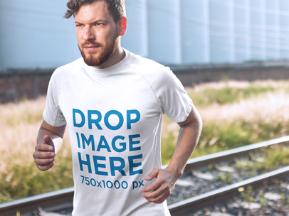 T-Shirt Mockup of a Man Running Near Some Train Tracks 7215a