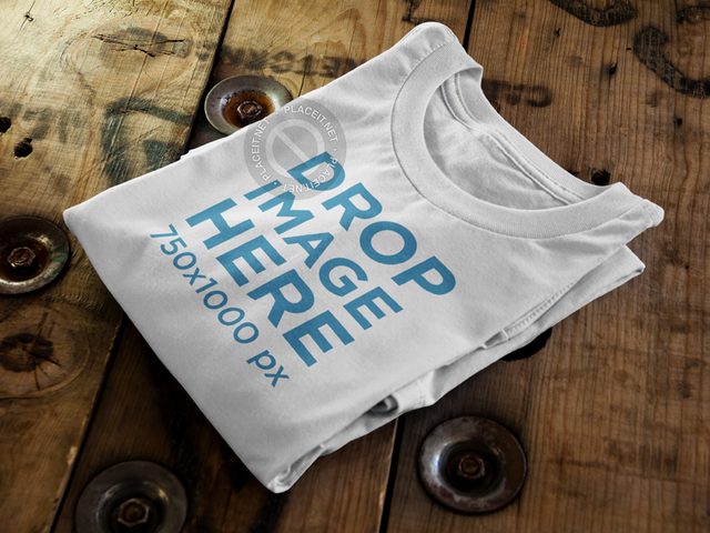 Folded T-Shirt Mockup Sitting On Top of a Wooden Table 6486a