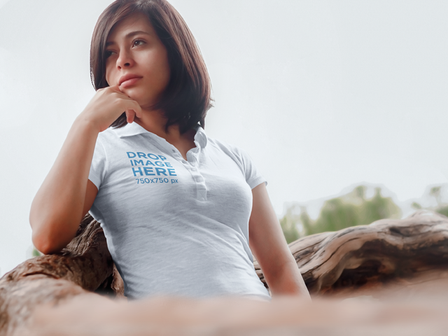 Polo Shirt Mockup of a Girl Standing Next to a Fallen Tree a6444