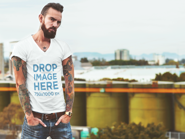 T-Shirt Mockup of a Tattooed Hipster Man at a Rooftop 1062a