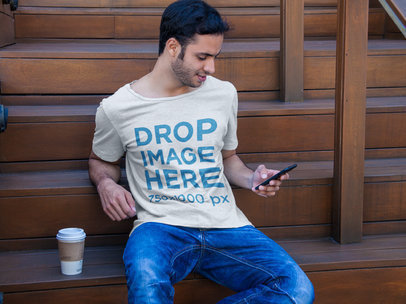 T-Shirt Mockup of a Man Sitting on a Staircase  a6501