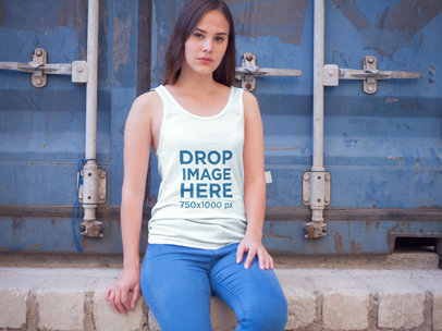 Tank Top Mockup of a Girl Sitting in Front of a Container a7901