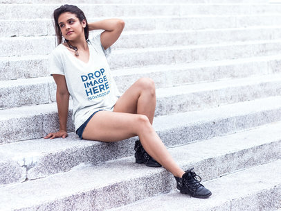 T-Shirt Mockup of a Girl Sitting on a Stone Staircase a7613