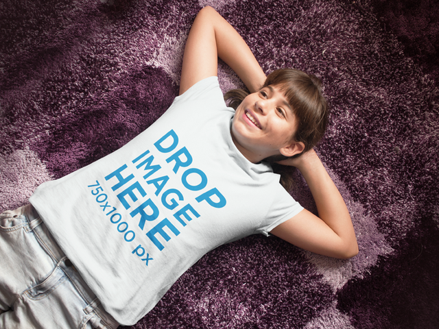 T-Shirt Mockup of a Young Girl Lying on a Rug a7965