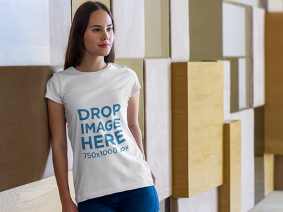 Young Woman Leaning Against a Wall T-Shirt Mockup a7976